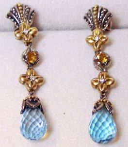 The shorter version of these fan-top earrings is fairly common but this longer version is not.
