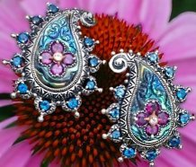 Earrings from Buddha's Bodhi abalone paisley suite, with London blue topaz and rhodolite.