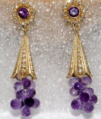Clustered amethyst faceted droplets extend from trumpet shaped caps, with sunburst top. In 18K, amethyst, and diamond. Photo by Eric Liquori.