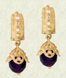 Faceted amethyst beads in 18K and diamonds.