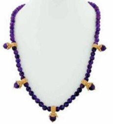Jacinda necklace has multiple stations on amethyst beads.
