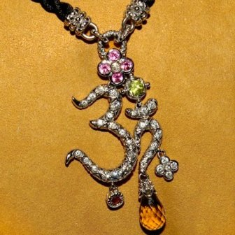 Yellow gold version of the diamond Om necklace.