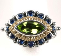 "Original ""evil eye"" ring in peridot with blue sapphire."