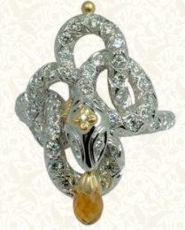 Diamond and 18K white gold snake ring with citrine briolette.