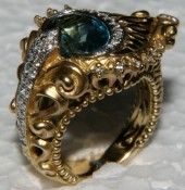"""Buckle-style"" peacock ring, in 18k and LBT. Photo: Eric Liquori"