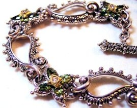 Openwork paisley bracelet with peridot starflower links. Also came in pto, bto, and pearl.