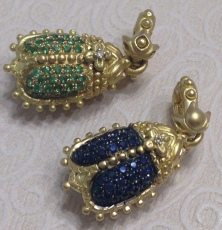Scarabs in tsavorite and sapphire.