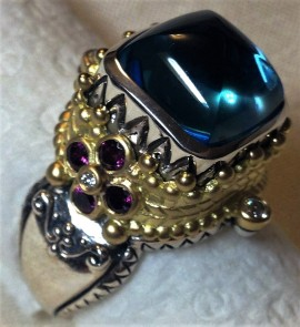 Tibetan ring: luscious blue topaz and rose garnet.
