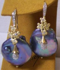 Moon Dance earrings: 18K gold, large keishi pearls, diamonds.