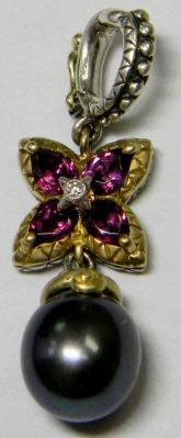 Rhodolite starflower and black pearl charm.
