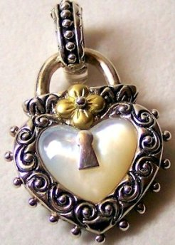 Mother of Pearl in sterling with 18K.