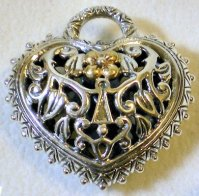 Reversible heart lock, openwork, with removable bail.