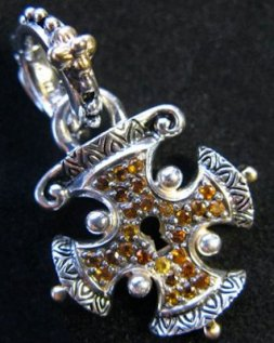 Maltese cross lock with pave citrine.