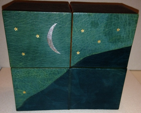 Book box, front. Night sky and mountain.