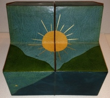 Book box, partially unfolded to face #2. Sun between the hills.
