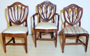 Three shield-back Hepplewhite chairs handcarved in mahogany by Lou Murter, featuring 3- and 5-splat motifs.