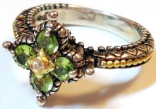 Couture Peridot signature flower ring with diamond center and gold beading on shank. Size 8.