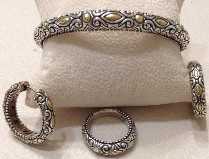All-metal signature marquise narrow cuff; matching hoops and stack ring.