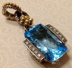 Blue topaz large cushion-shaped enhancer with diamonds.