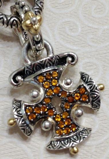 Citrine maltese cross charm.