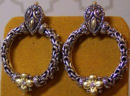 """Couture Front-facing """"door-knocker"""" style hoops with diamonds."""