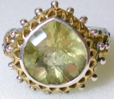 Wide-pear limon quartz ring.