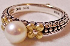 White pearl solitaire with gold flowers.