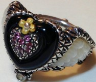 Winged heart ring with mother-of-pearl, onyx, and pink garnet. Size 6.