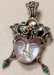 Quan Yin enhancer: abalone, rhodolite, turquoise