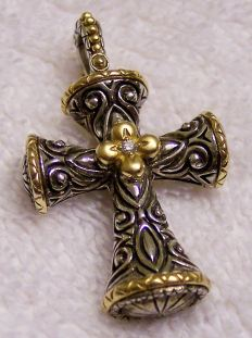 Signature flower cross.