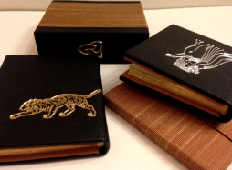 Book bound in black split French goat, stamped in silver and gold.