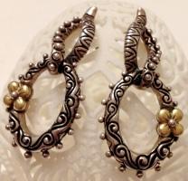 """All metal oval """"doorknocker"""" earrings."""