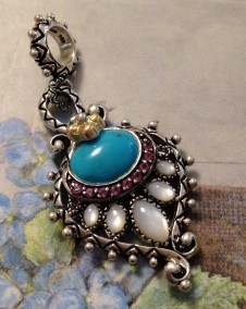 Peacock charm with turquoise, MOP and rhodolite.