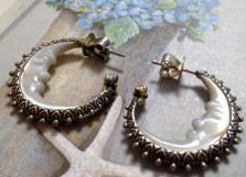 Carved MOP man-in-the-moon hoop earrings with posts.