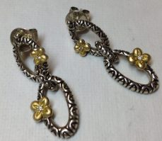 Couture double-link earrings with gold, diamond-centered flowers. Posts