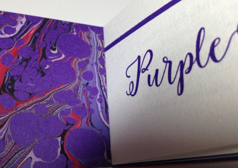 Regal purple commands the page.