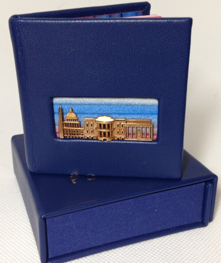 Deluxe binding of DC Portals in royal blue leather with paste-papers. Shown with box.